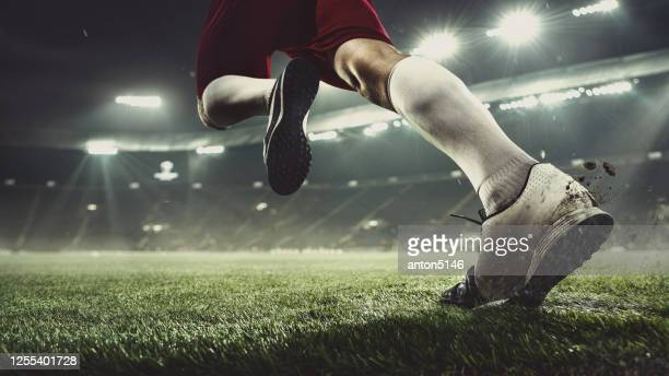 close up football or soccer player at stadium in flashlights - motion, action, activity concept - the championship football league stock pictures, royalty-free photos & images
