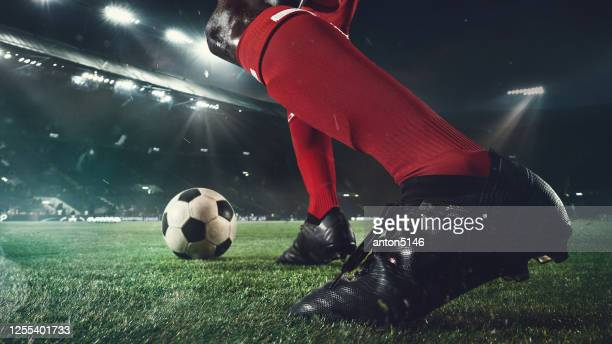 close up football or soccer player at stadium in flashlights - motion, action, activity concept - the championship soccer league stock pictures, royalty-free photos & images