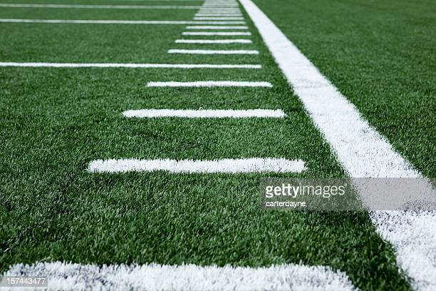 Close up football stadium artificial grass and markings