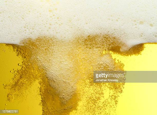 close up frothy beer bubbles - empty stock pictures, royalty-free photos & images