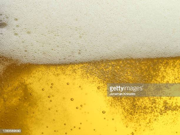 close up frothy beer - bubble stock pictures, royalty-free photos & images