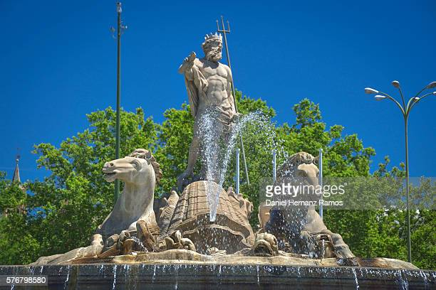 Close up Fuente de Neptuno against blue sky in Madrid Spain