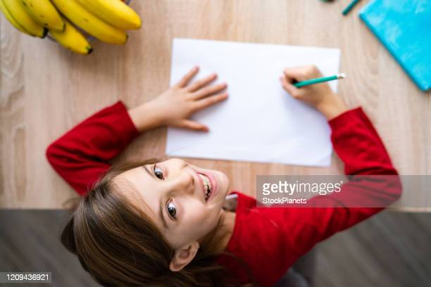close up girl with notebook - workbook stock pictures, royalty-free photos & images