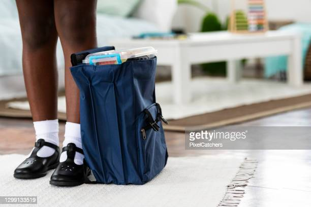 close up girls feet in new school shoes with satchel full of books - footwear stock pictures, royalty-free photos & images