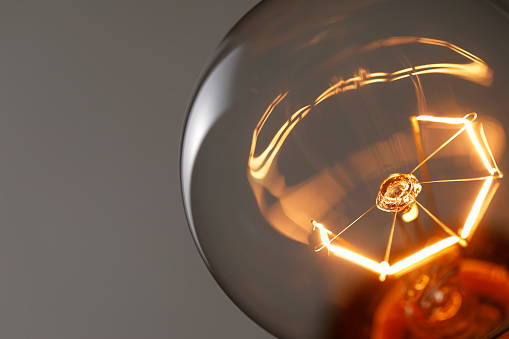 Close up glowing light bulb 1023583332
