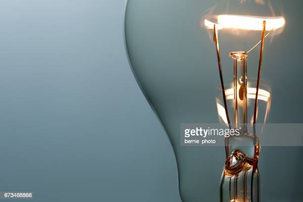 close up glowing light bulb - novo imagens e fotografias de stock