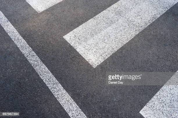 close up graphic view of a zebra crossing - paso de cebra fotografías e imágenes de stock