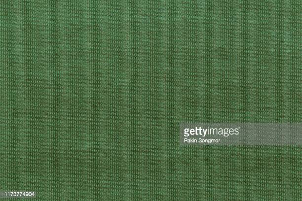 close up green fabric texture. textile background. - cotton harvest stock pictures, royalty-free photos & images