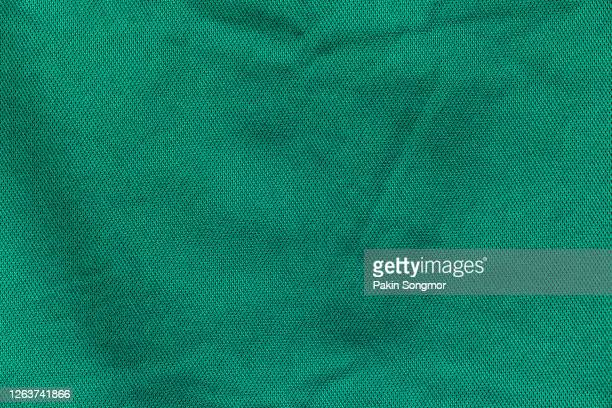 close up green fabric texture. textile background. - textile stock pictures, royalty-free photos & images