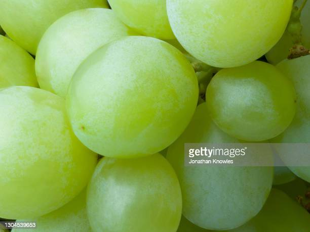 close up green grapes - extreme close up stock pictures, royalty-free photos & images