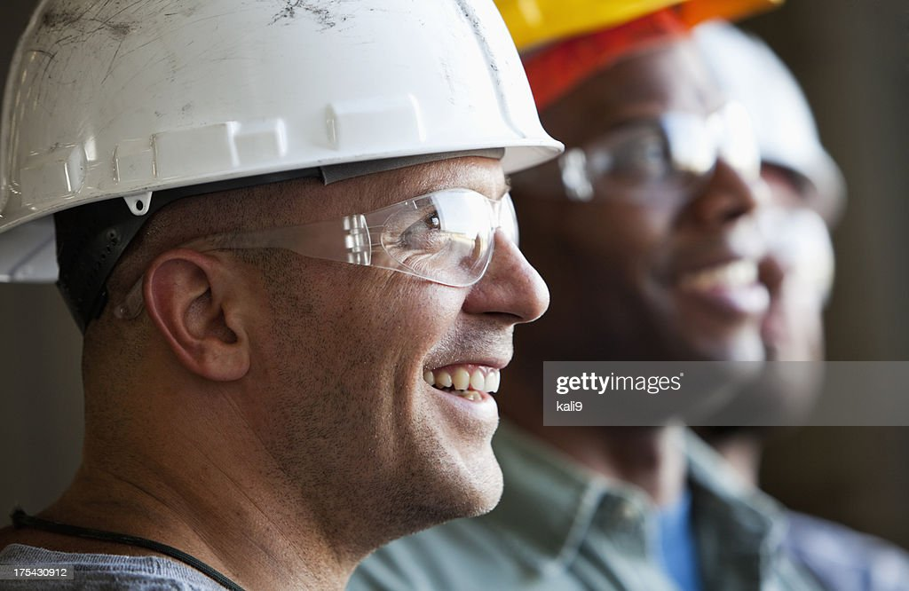 Close up group of construction workers : Stock Photo