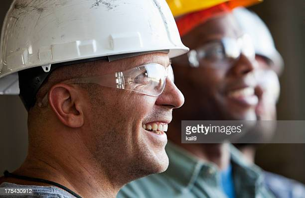 close up group of construction workers - arbeider stockfoto's en -beelden