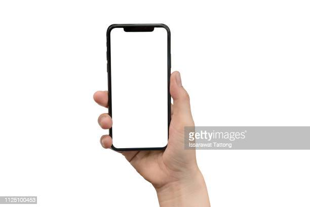 close up hand hold phone isolated on white, mock-up smartphone white color blank screen - halten stock-fotos und bilder