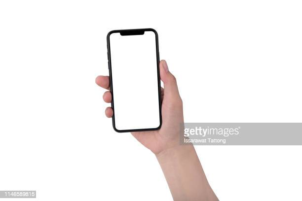 close up hand hold phone isolated on white, mock-up smartphone white color blank screen - iphone mockup stock pictures, royalty-free photos & images