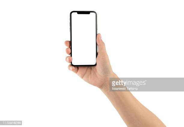 close up hand hold phone isolated on white, mock-up smartphone white color blank screen - telephone stock pictures, royalty-free photos & images