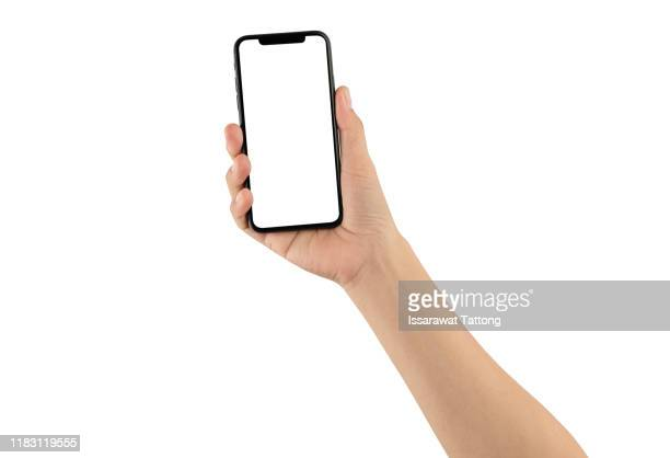close up hand hold phone isolated on white, mock-up smartphone white color blank screen - photo messaging stock pictures, royalty-free photos & images