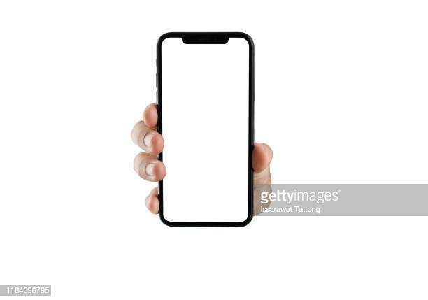 close up hand hold phone isolated on white, mock-up smartphone white color blank screen - tonen stockfoto's en -beelden