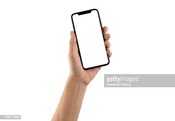 close up hand hold phone isolated on white, mock-up smartphone white color blank screen - dispositivo de informação portátil imagens e fotografias de stock