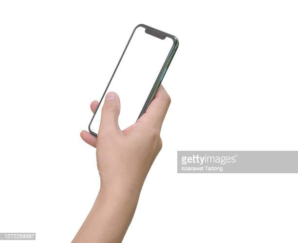 close up hand hold phone isolated on white, mock-up smartphone white color blank screen - 手 ストックフォトと画像