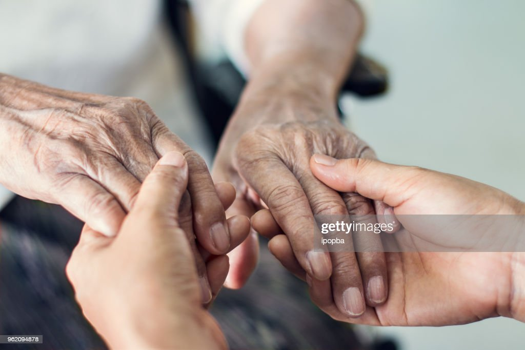 Close up hands of helping hands elderly home care. Mother and daughter. Mental health and elderly care concept : Stock Photo