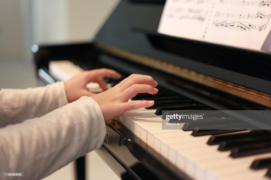 Close up hands playing piano. : ストックフォト