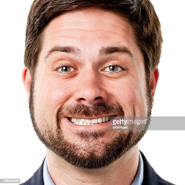 Close Up Headshot Of Man With Cheesy Grin