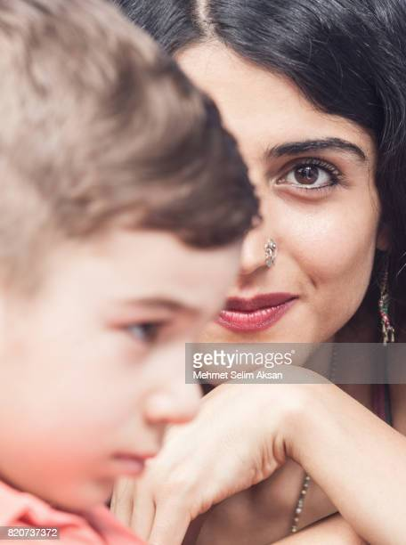 Close Up Headshot Of Mixed Race Young Nanny And Little Boy