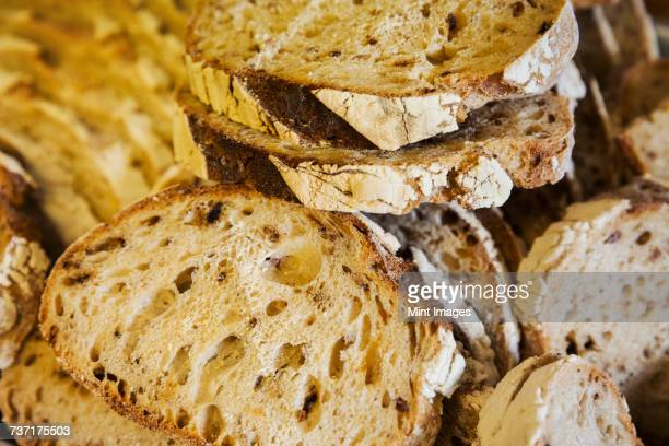 Close up high angle view of freshly baked slices of bread.
