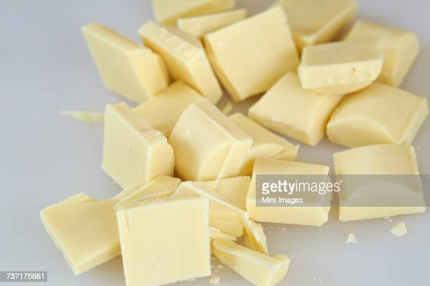 Close up high angle view of pieces of white chocolate.