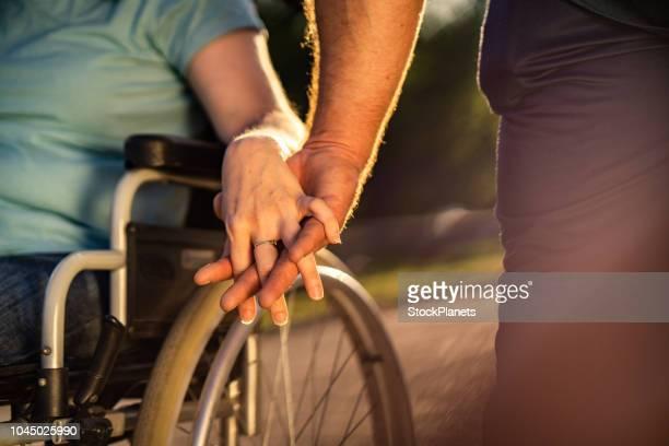 close up holding hand to invalid person - rispetto foto e immagini stock