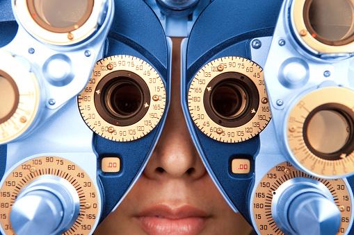 close up horizontal of optometry machine blue and orange 117145533
