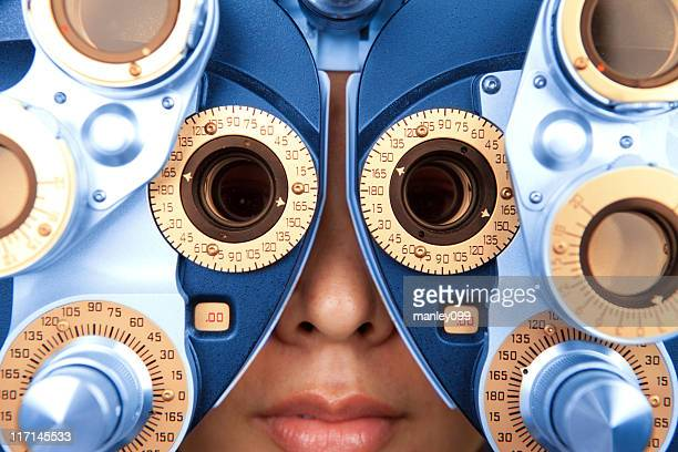 close up horizontal of optometry machine blue and orange - lens optical instrument stock pictures, royalty-free photos & images