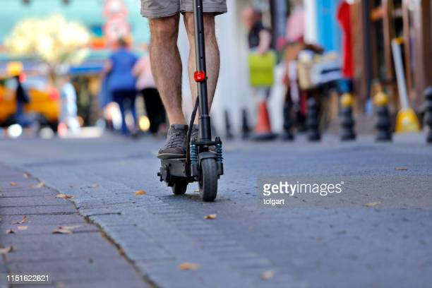 close up image of a man on an electric scooter - mobility scooter stock photos and pictures