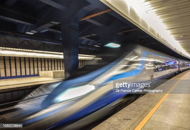 close up image of a pendolino train leaving warsaw centralna railroad station (central station) in poland - 高速列車 ストックフォトと画像