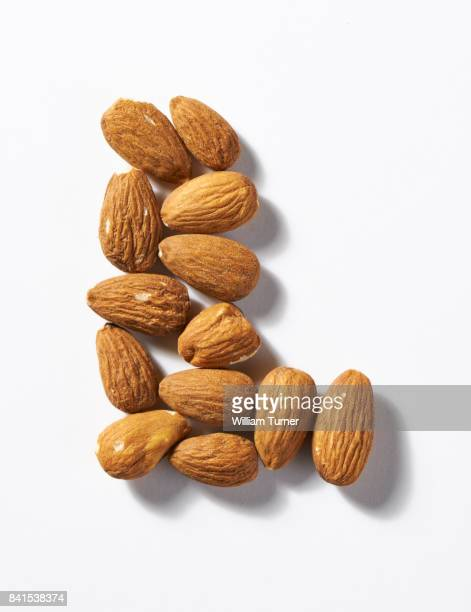 A close up image of almond nuts in the shape of a letter L