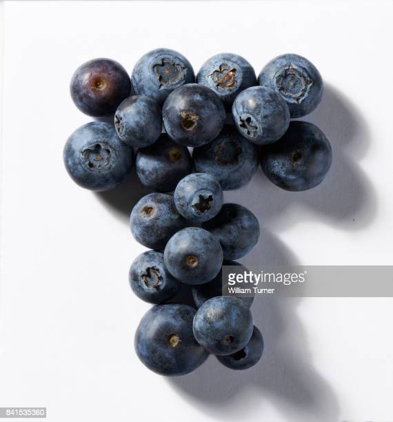 a close up image of blueberries in the shape of a letter t - letter t stock pictures, royalty-free photos & images