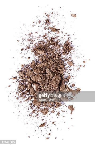A close up image of brown eye shadow makeup