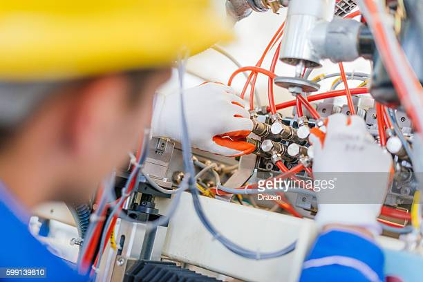 Close up image of engineer setting up valves