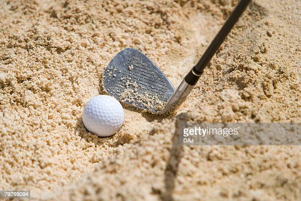 Close Up Image of Golf Ball in Bunker