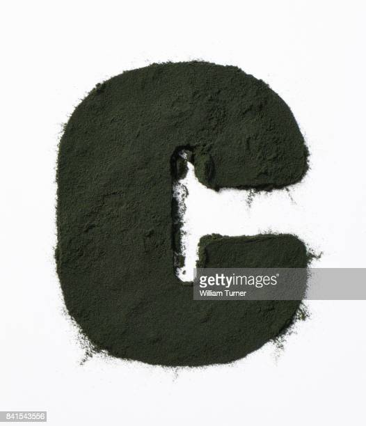 A close up image of kale powder in the shape of a letter C