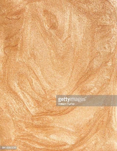 A close up image of metallic gold nail varnish or polish