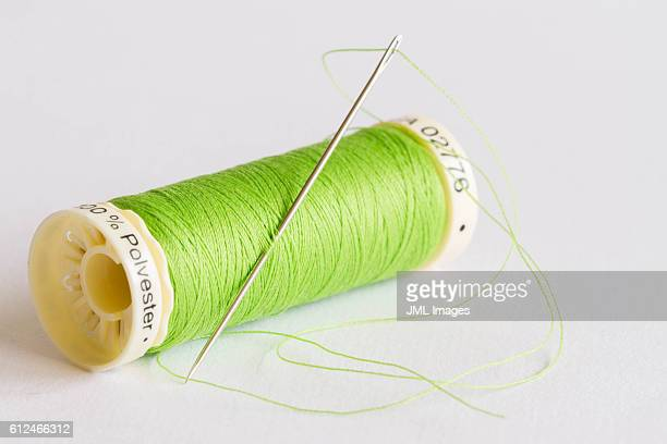 close up image of needle and thread - thread stock pictures, royalty-free photos & images