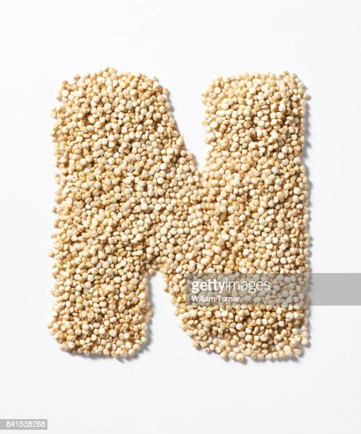 A close up image of quinoa grains in the shape of a letter N