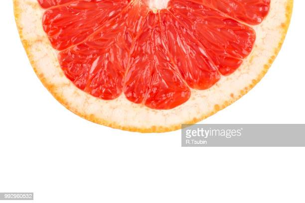 close up image of sliced red grapefruit - grapefruit red stock pictures, royalty-free photos & images