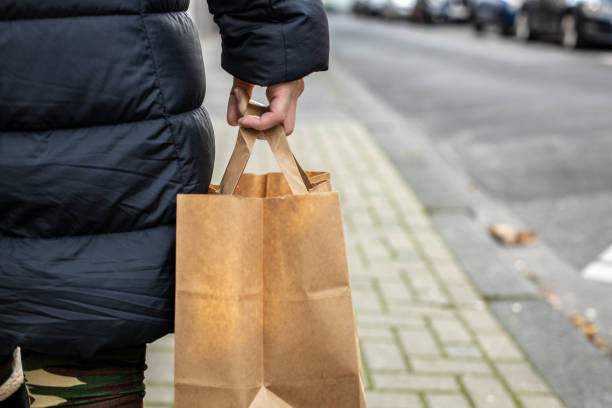 Close up in hand holding paper bag on the street
