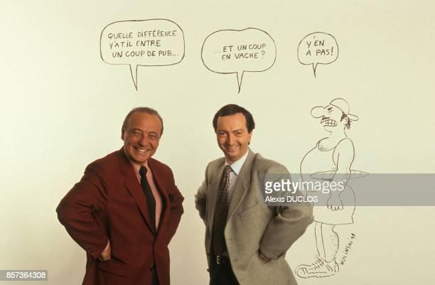 Close up Jacques Seguela et MichelEdouard Leclerc devant un dessin de Wolinski le 25 mars 1991 a Paris France