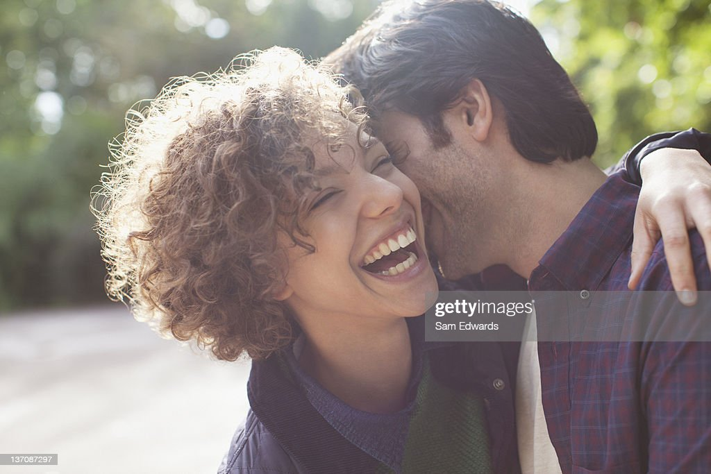 Close up laughing couple hugging : Stock Photo