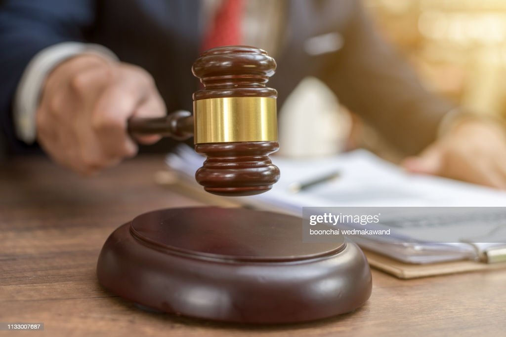 Close up lawyer businessman working or reading lawbook in office workplace for consultant lawyer concept. : Stock Photo