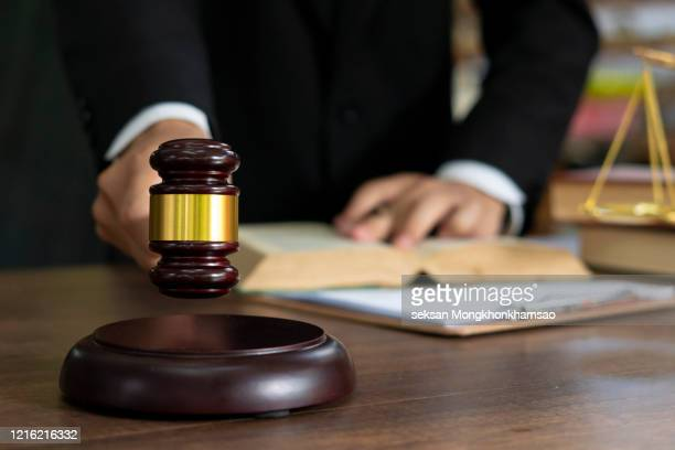 close up lawyer businessman working or reading lawbook in office workplace for consultant lawyer concept. - mallet hand tool stock pictures, royalty-free photos & images