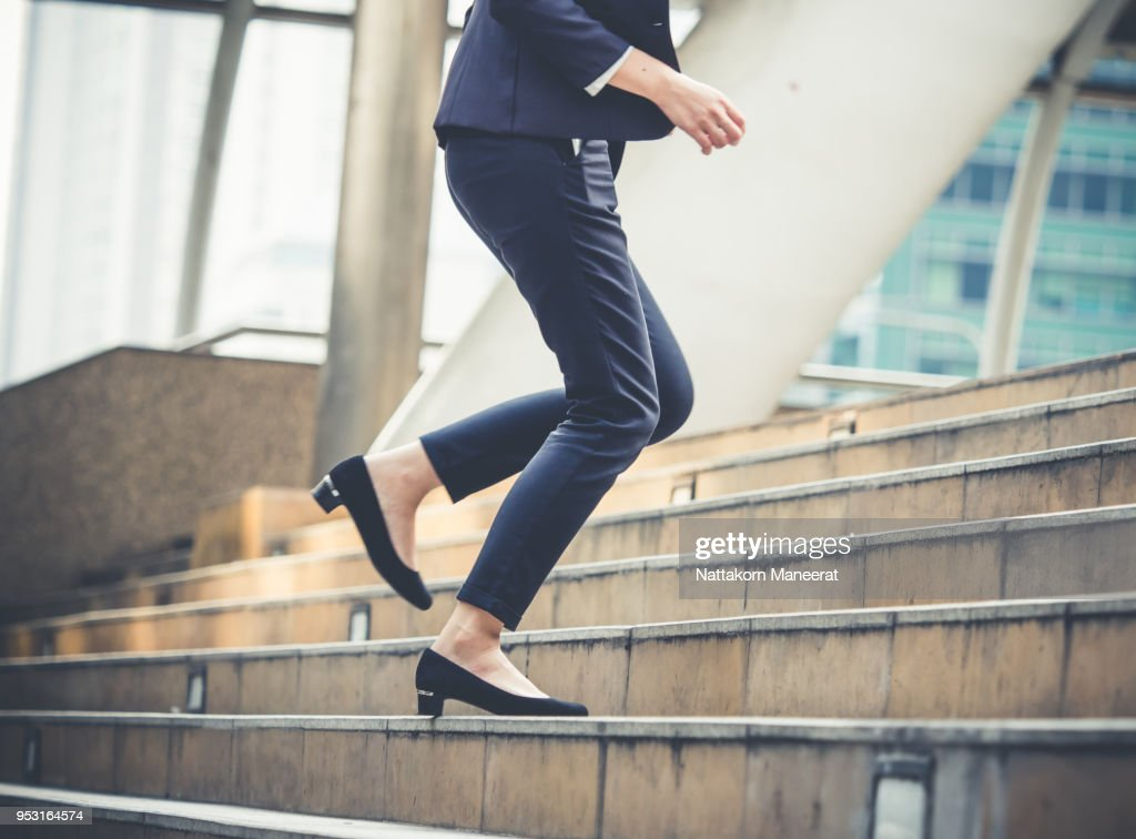 Close up legs of businesswoman walking stepping up stair in modern city, business growth, go up, success, grow up business concept : Stock Photo